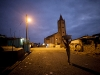 OTUAM, GHANA- OCTOBER 4 : A young girl walks home after gathering water before dawn in Otuam, Ghana on October 4, 2009. The small town of Otuam has a population of approximately 7000 people but no running water. A problem the new King Peggielene
